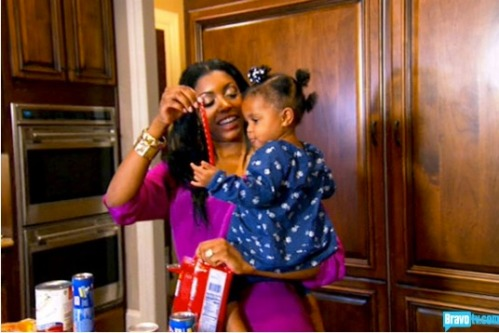 Porsha know Twizzlers are the perfect snack for a year old - it's like she's been doing this for years!