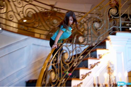 Milania shows us her skills working the banister in her new bra.