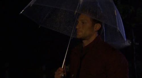 A man and his girlie umbrella.